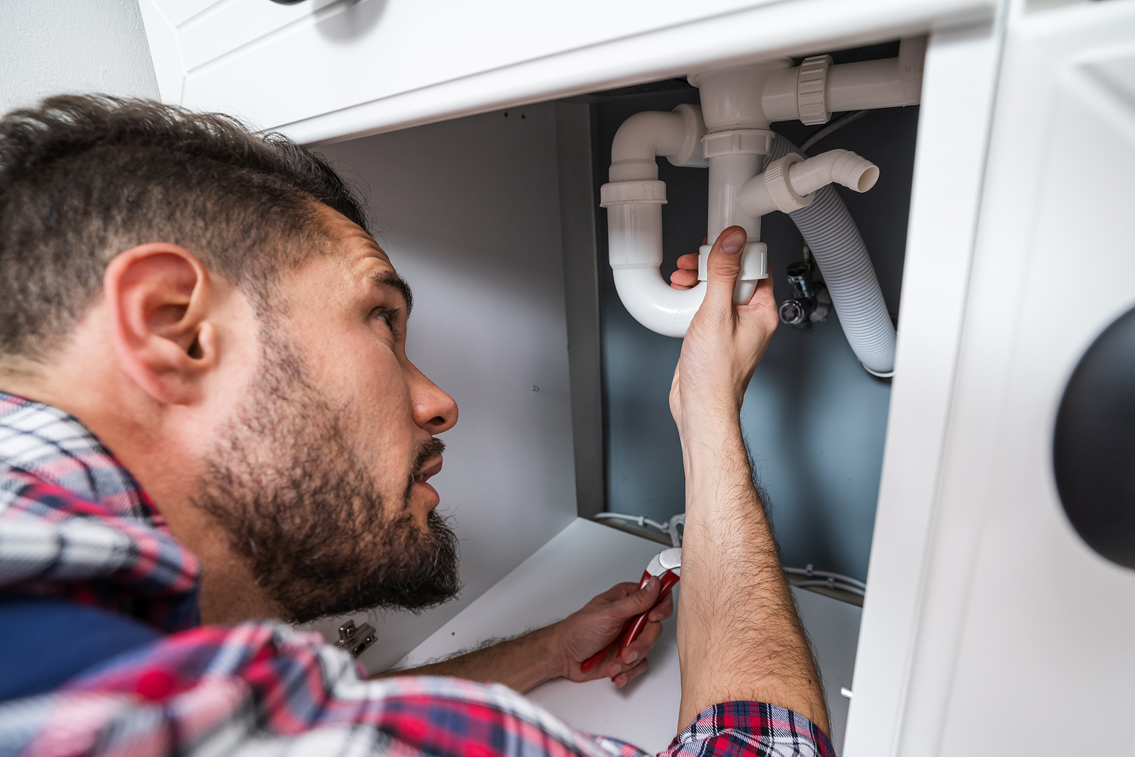 Canberra Plumber fixing the sink
